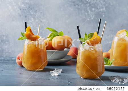 Fresh apricot cocktail with ice and mint 66952125
