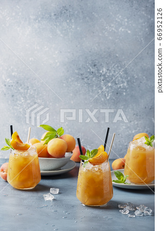 Fresh apricot cocktail with ice and mint 66952126