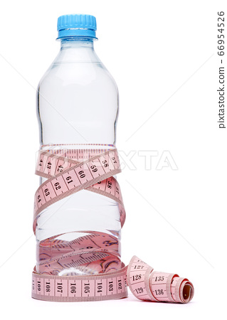 Plastic bottle of drinking water and measuring tape isolated on white background with clipping path 66954526