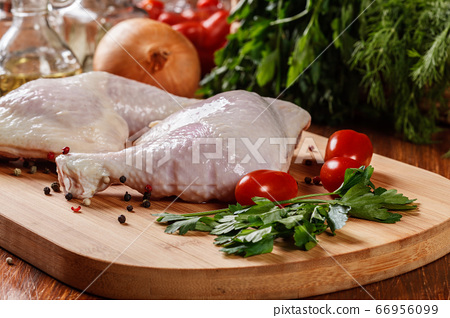 Raw chicken legs and marinade ingredients 66956099