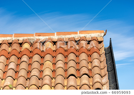 Roof with Terracotta tiles and gutter in Italy - Pantiles 66959093
