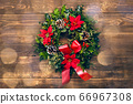Amazing Christmas wreath with big red bow on wooden background 66967308