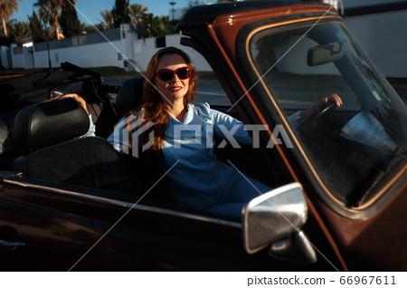 Woman in cabriolet 66967611