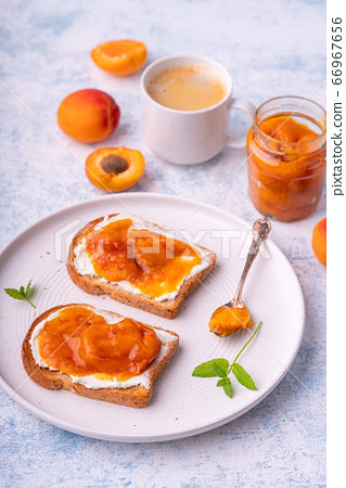 Homemade apricot jam and creme cheese toasts. 66967656
