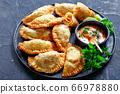 hot juicy Buffalo Chicken Empanadas, top view 66978880