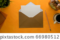 Open mock-up invitation card with brown envelope 66980512