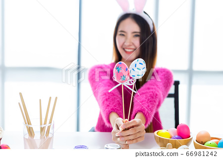 Easter holiday concept,Happy smile Asian Young 66981242