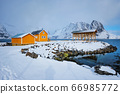 Rorbu house and drying flakes for stockfish cod fish in winter. Lofoten islands, Norway 66985772