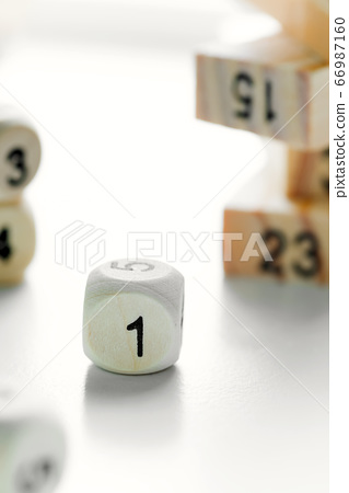 Number one on the face of wooden dice cube on a 66987160