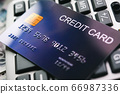 Credit card on calculator background for financial concept 66987336