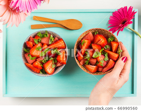Fruit salad with strawberry, watermelon, basil leaves 66990560