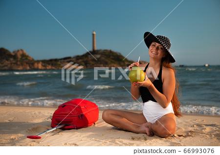 Woman on tropical beach 66993076