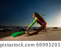 Woman in swimsuit with a surfboard 66993203