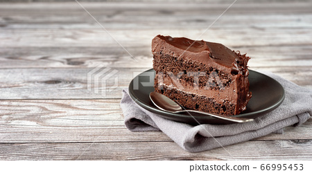 A peace of vegan chocolate davil cake on grey 66995453