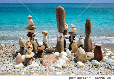 Concept of balance and harmony - pebble stone stacks on the beach 66996180
