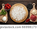 Process of making homemade pizza with mozzarella 66998173