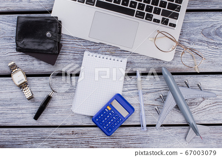 Blank notepad and international business items flat lay. 67003079