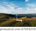 Huge high wind generator in the mountains of Montenegro near the house. 67009259
