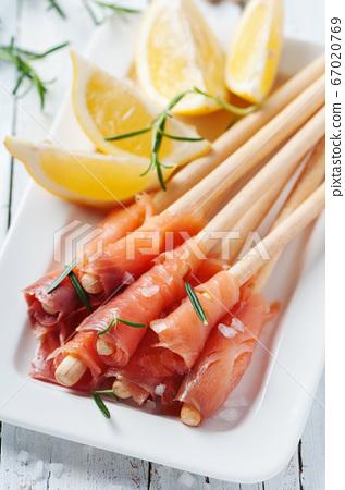 Smoked salmon with lemon and rosemary 67020769