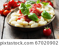 Italian gnocchi with tomato and basil 67020902