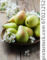 Sweet fresh pears on the wooden table 67021252