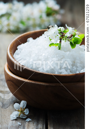 White salt and flowers for spa treatment 67021259