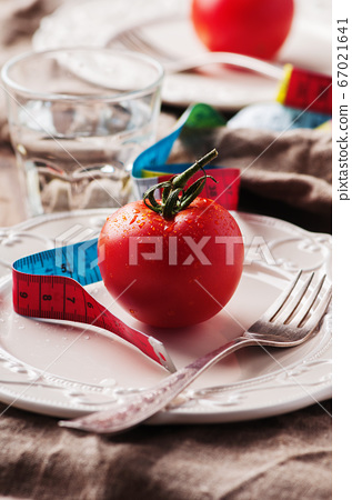 Concept of diet with red tomato and water 67021641
