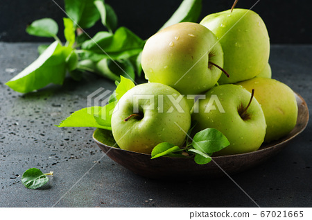 Green sweet apple on the table 67021665