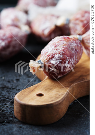 Delicious italian salami on the table 67021730