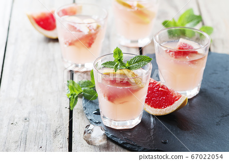 Pink cocktail with ice and mint 67022054