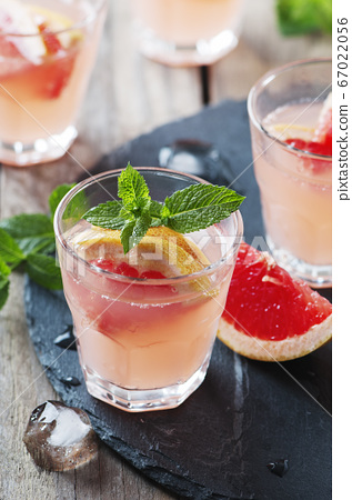 Pink cocktail with ice and mint 67022056