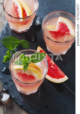 Pink cocktail with ice and mint 67022057