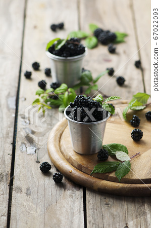 Sweet fresh blackberry on the wooden table 67022093
