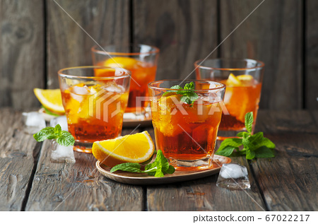 Glass of aperol with ice, orange and mint 67022217