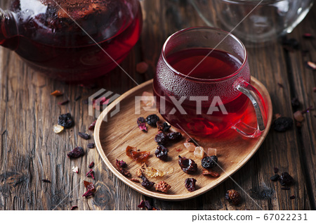 Red hot tea on the wooden table 67022231