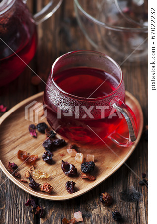 Red hot tea on the wooden table 67022232