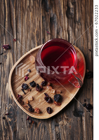 Red hot tea on the wooden table 67022233