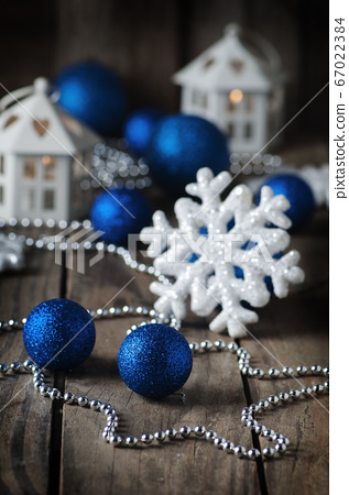 Christmas ornament with balls on the wooden table 67022384
