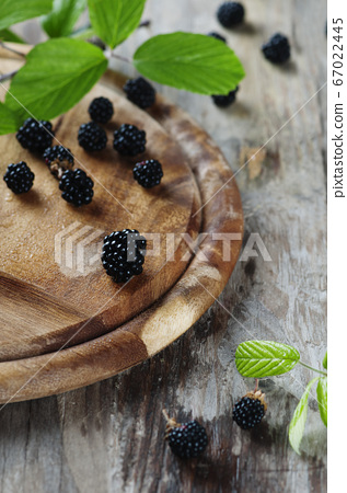Fresh sweet blackberry on the wooden table 67022445
