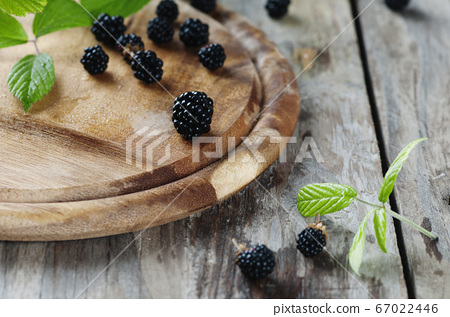 Fresh sweet blackberry on the wooden table 67022446