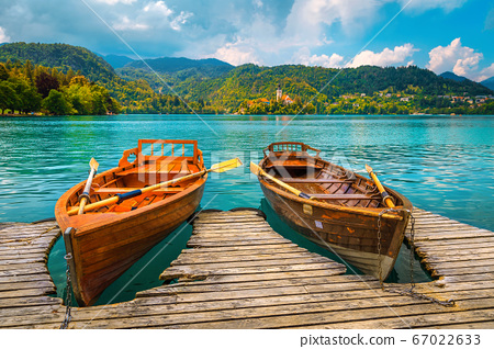Traditional wooden boats moored on the lake Bled, Slovenia 67022633