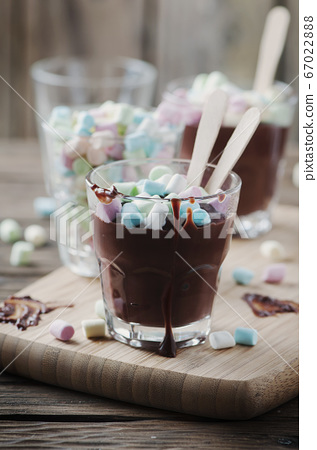 Hot chocolate with marshmallow on the wooden table 67022888
