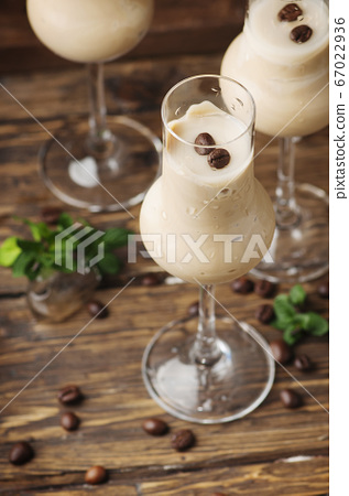 Cold cream with coffe and mint on the wooden table 67022936