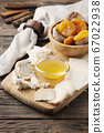 Mix of different cheese with honey 67022938