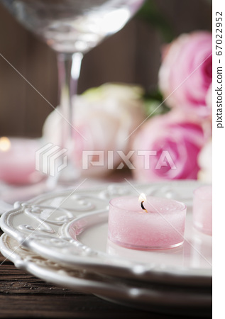 Pink candle and roses on the table 67022952