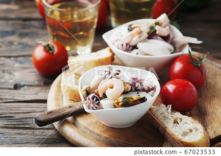 Seafood salad with white wine 67023533