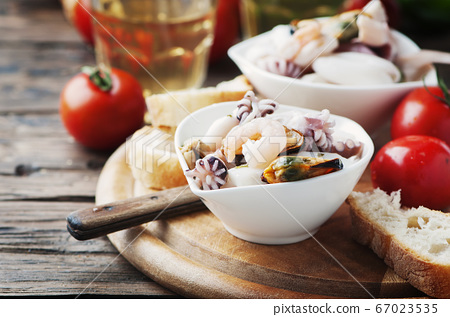 Seafood salad with white wine 67023535