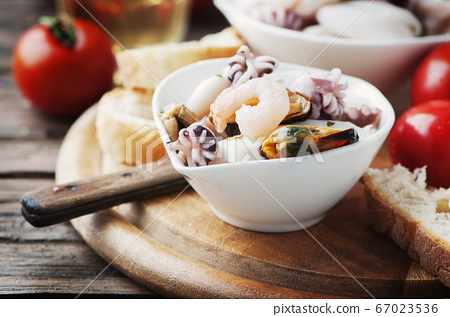 Seafood salad with white wine 67023536