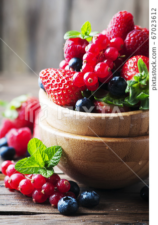 Mix of berry on the wooden table 67023612