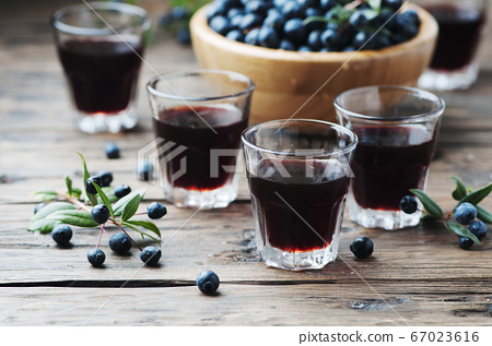 Traditional sardinian liqueur with mirto 67023616